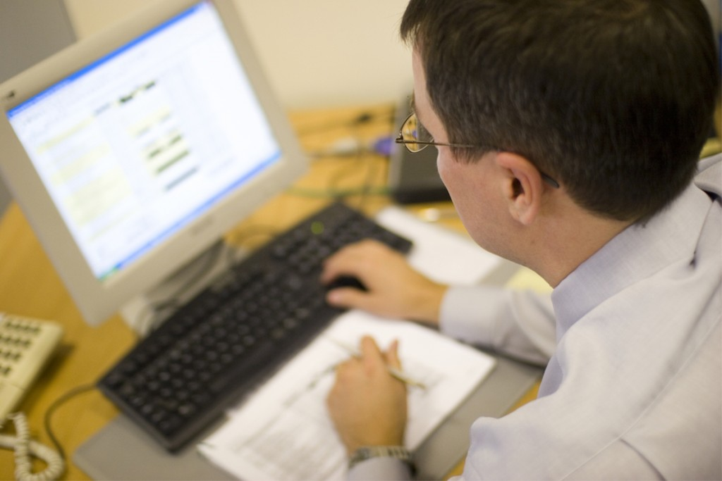 man using office computer